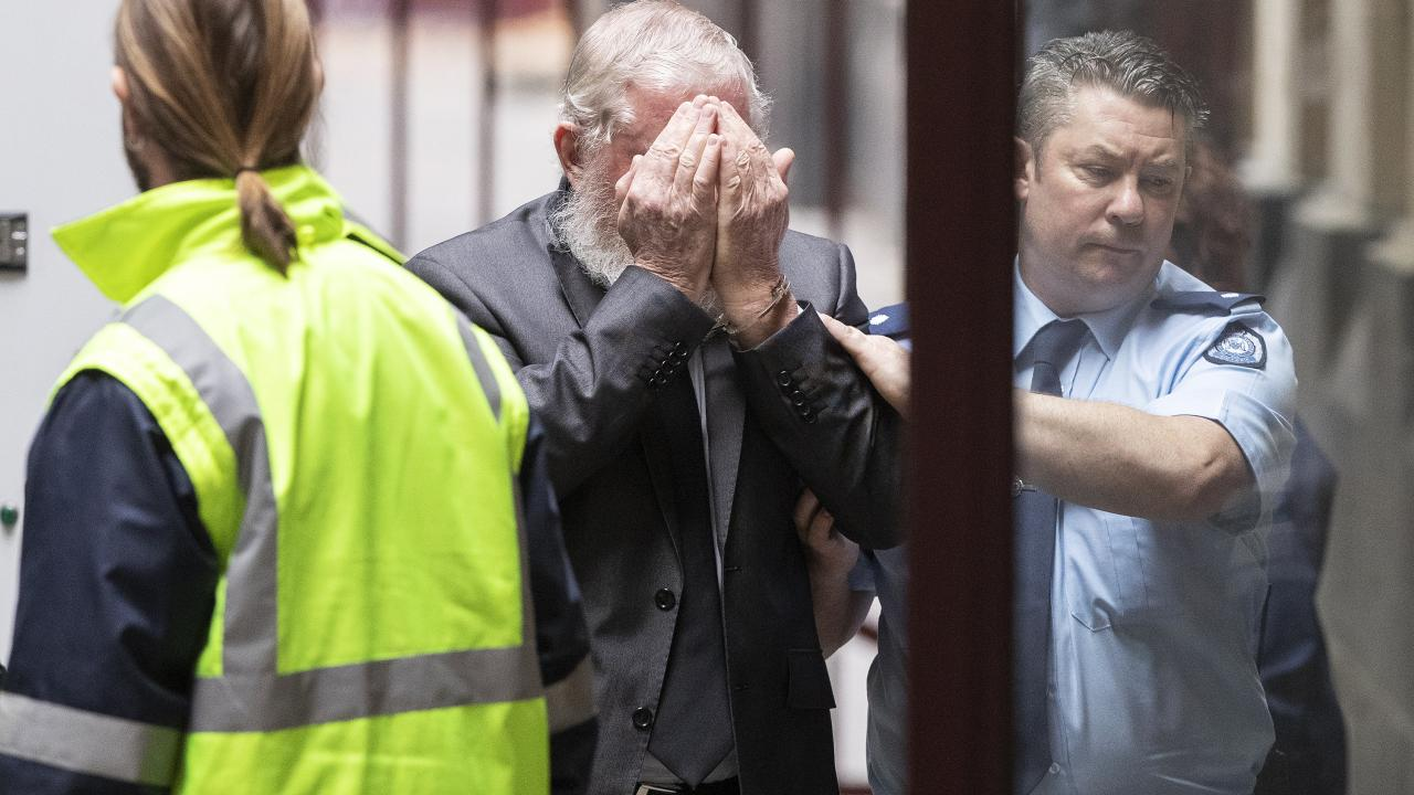 James Dobbie shielded his face as he arrived at the Supreme Court of Victoria in Melbourne this morning. Picture: Daniel Pockett/AAP