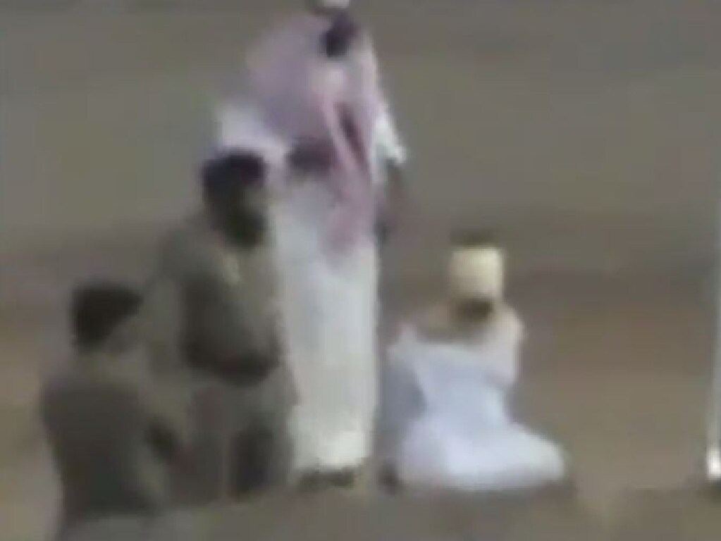 A Saudi official prepares to behead a bound and blindfolded prisoner. Picture: Liveleak
