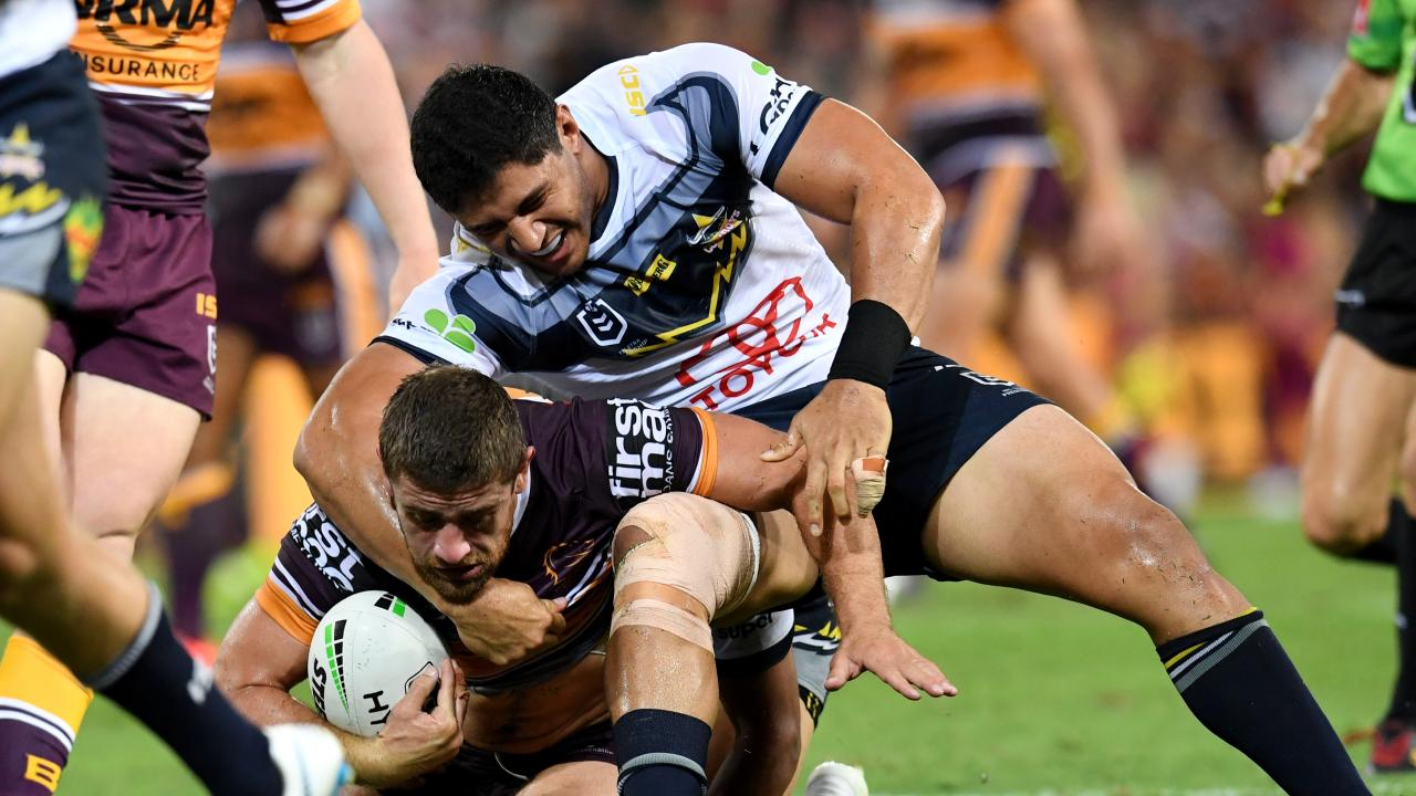 Jason Taumalolo tackles Andrew McCullough of the Broncos.