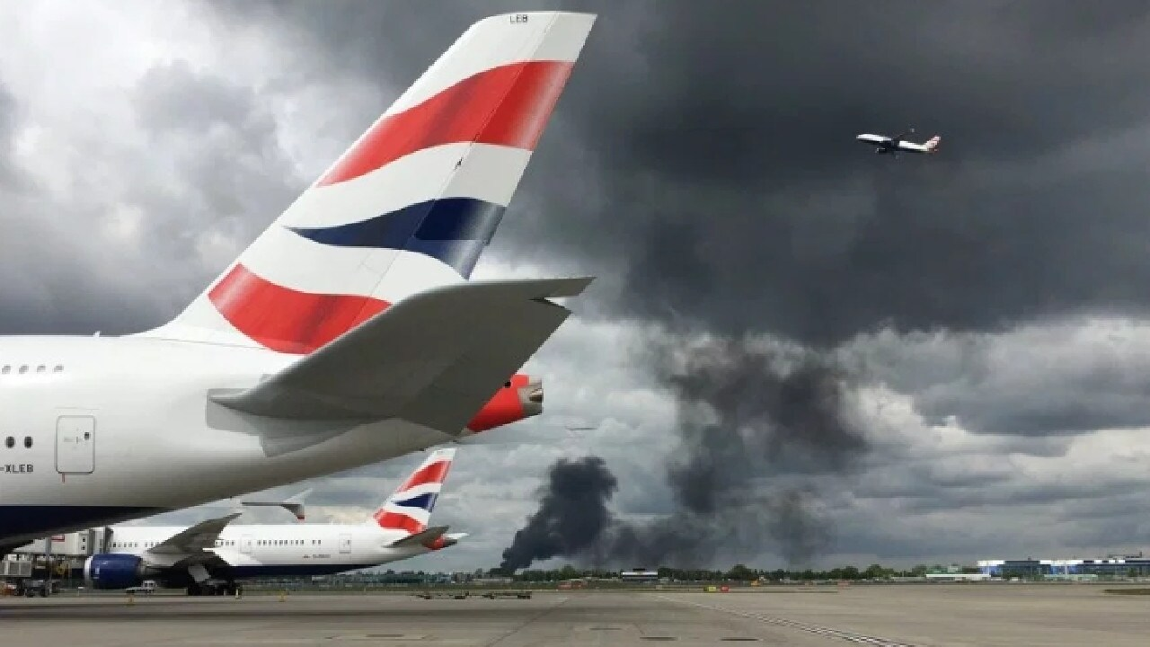 Black smoke fills the air at Heathrow Airport.