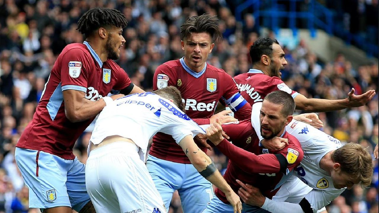 Teams clash during the controversial draw between Leeds and Aston Villa.