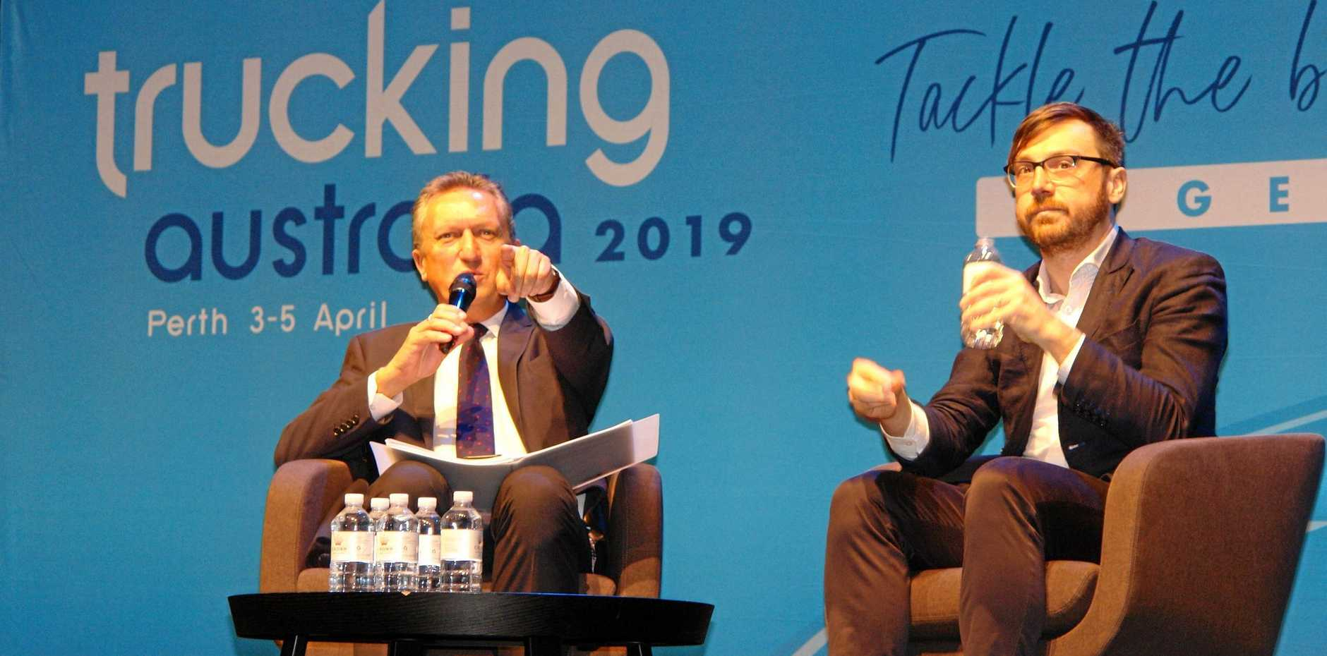 GET TO THE POINT: ATA chairman Geoff Crouch (left) and Eamon McGinn talk numbers with delegates at TA2019 in Perth.