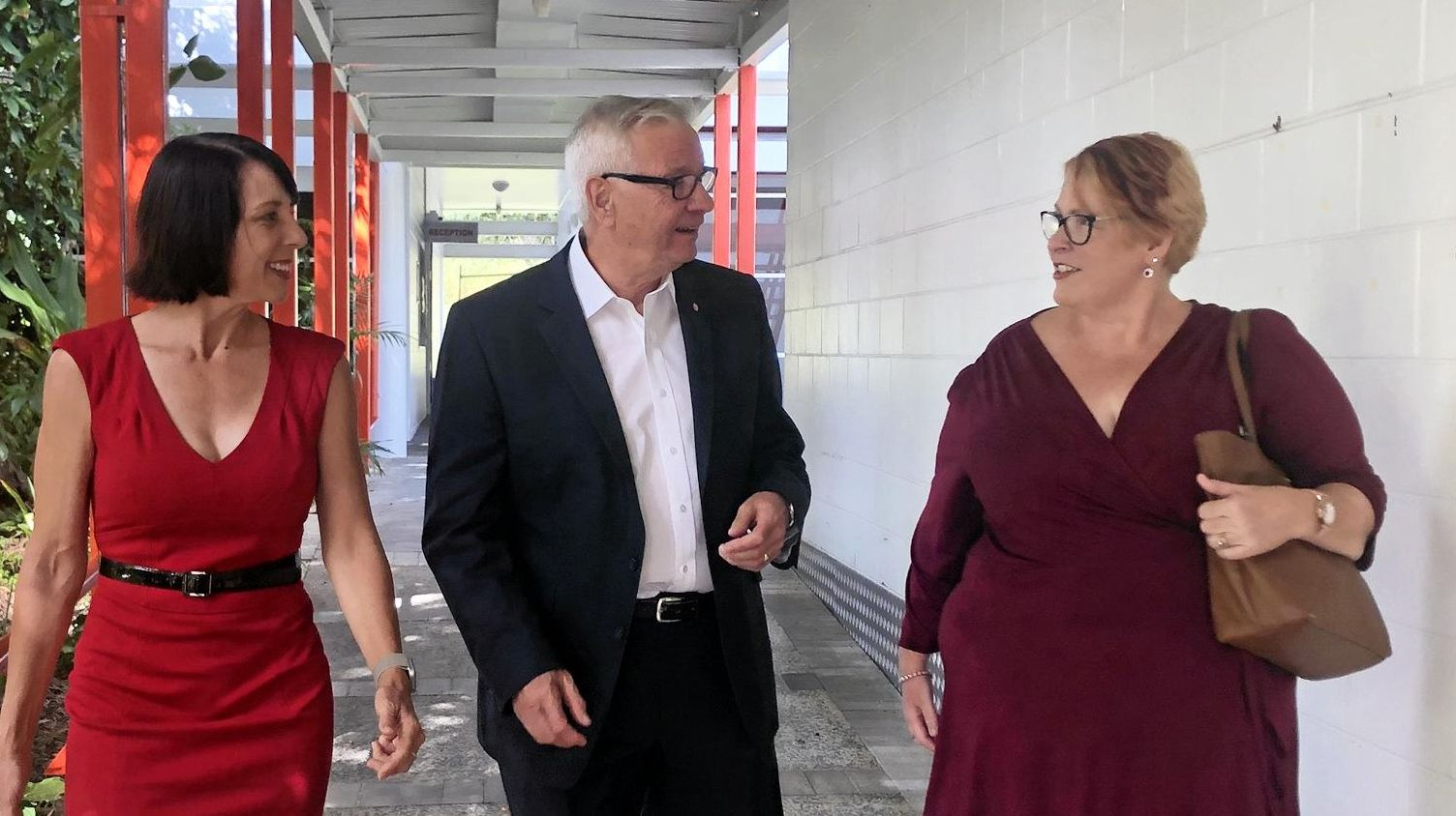 Labor candidate for Dawson, Belinda Hassan and Senator Doug Cameron visit TAFE Queensland's Cannonvale campus with TAFE Queensland executive director Susan Kinobe.