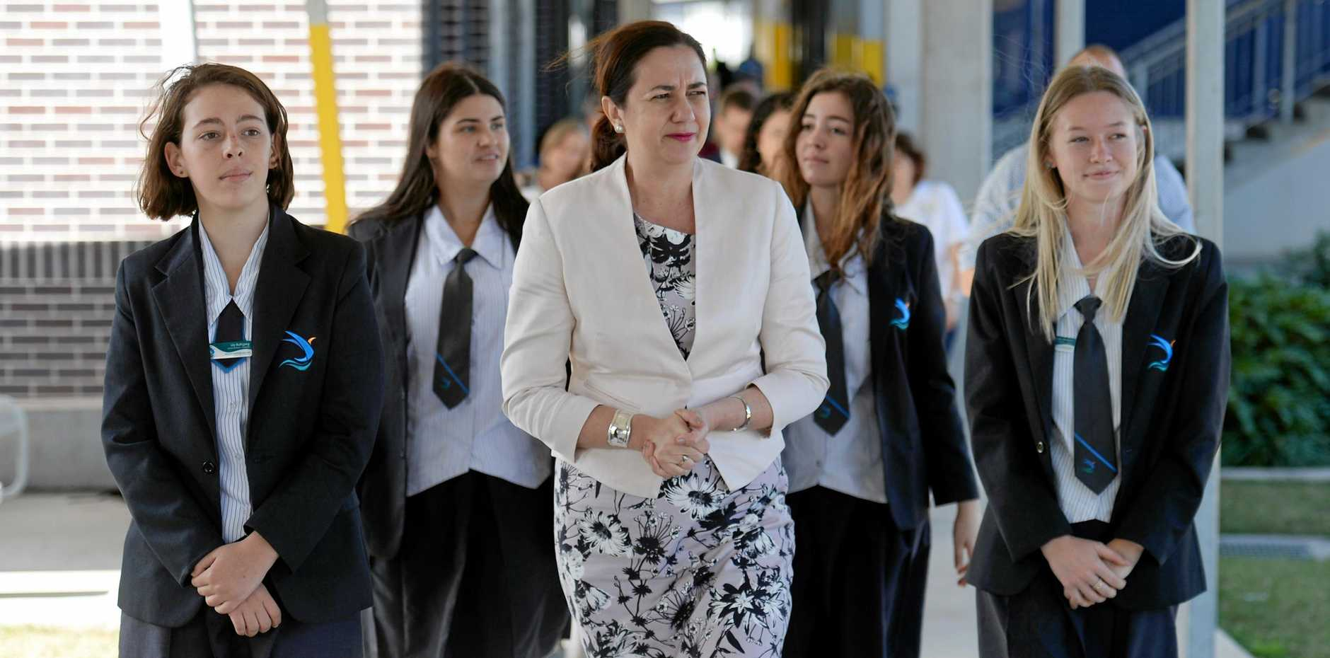 Premier Annastacia Palaszczuk inspect construction of a Performing Arts Centre at Mackay Northern Beaches State High School with students Lily Buttigieg, Madison Friese, Helene Buttigieg and Ruby Sharam