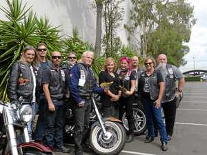 Biker group bands together to give service donation