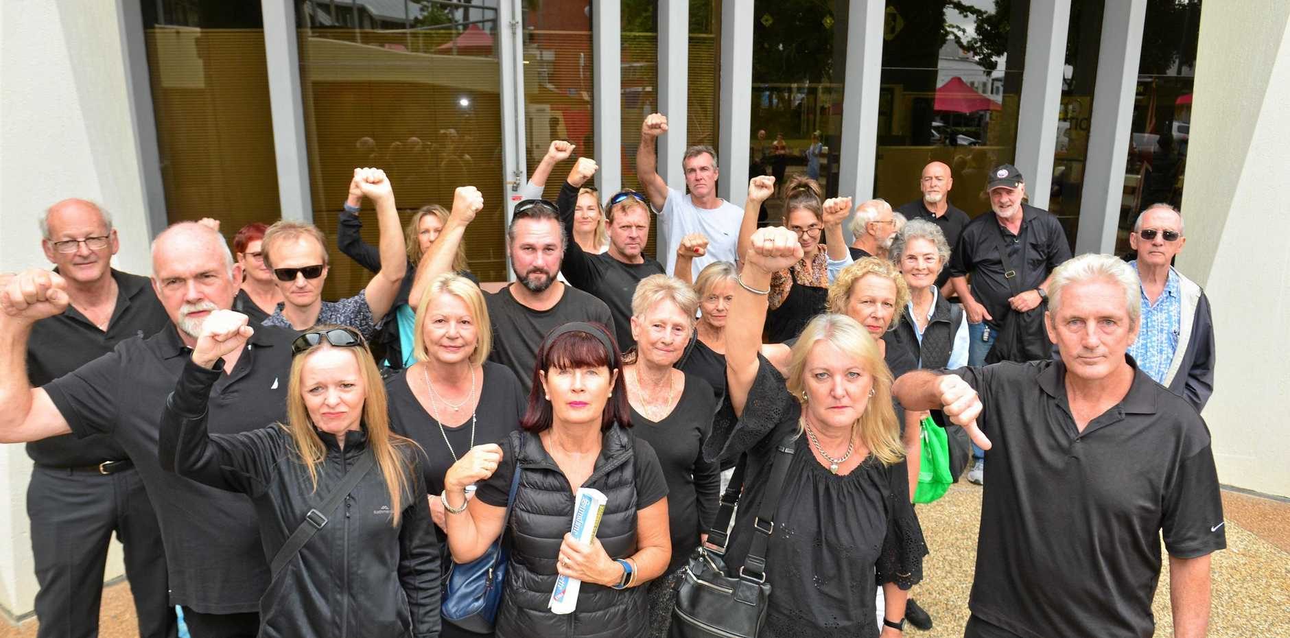 Buddina residents dressed in black to protest outside City Hall ahead of a decision on a a 73-unit apartment towner. .