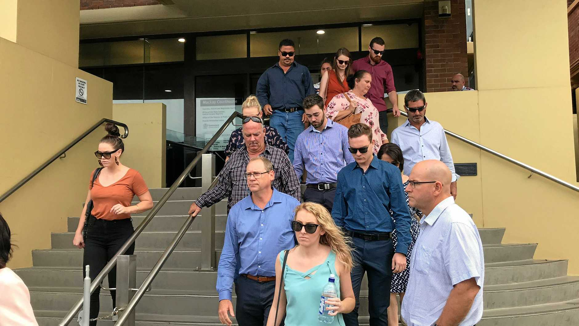 TRAGIC CASE: Zachary Ty Gaston, 21, (middle in light blue shirt) leaves Mackay Courthouse surrounded by loved ones after pleading guilty to a fatal crash that killed his mate at Eungella in 2017.