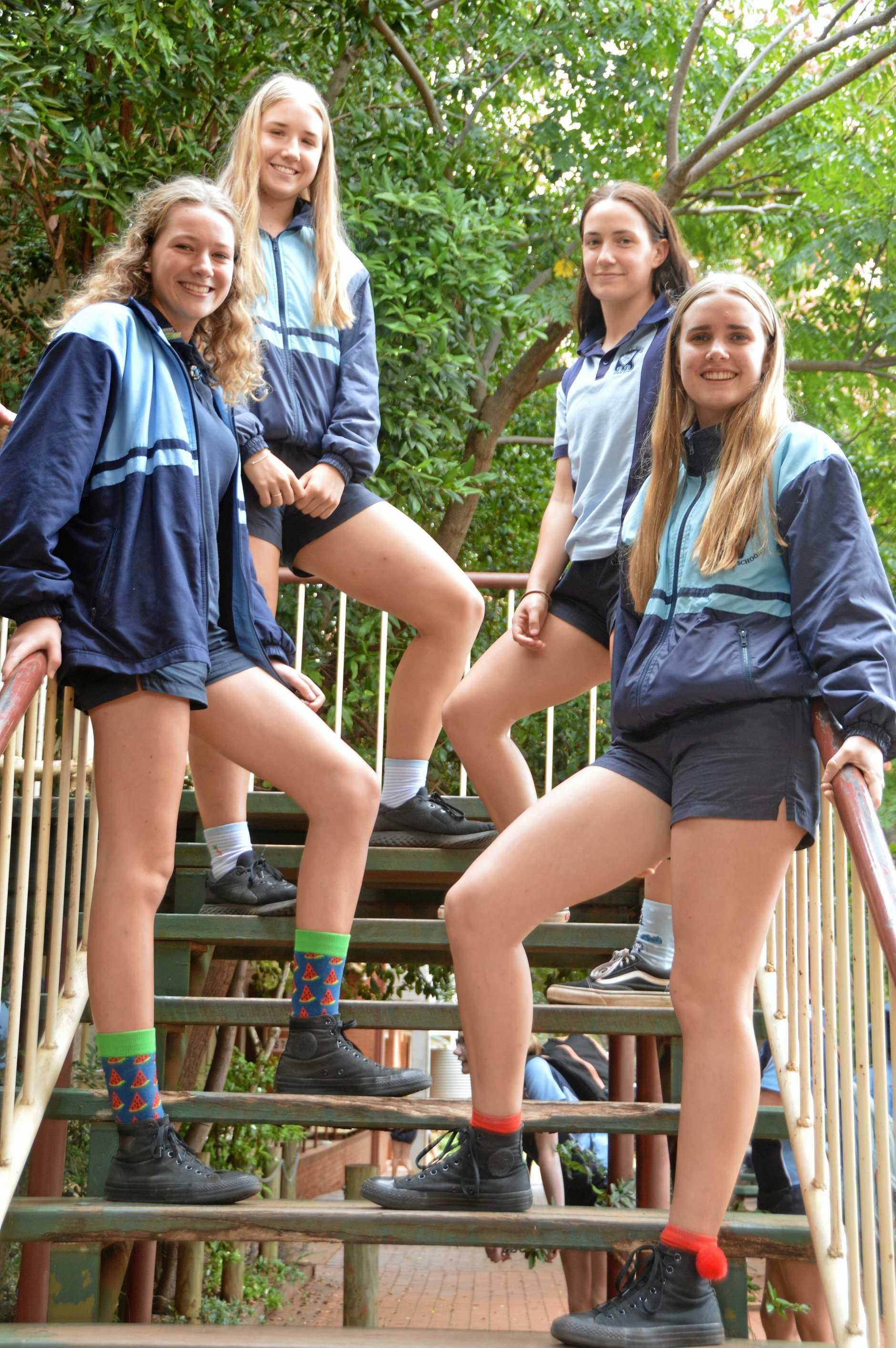 SUPPORTING THEIR OWN: Kingaroy State High School students Rayne Hunt, Laura Tessmann, Taylah Favier and Emma Stewart sport crazy socks to raise funds for their classmate Kalila.