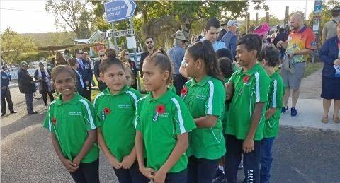 PAYING THEIR RESPECTS: Cherbourg Rangers commemorate Anzac Day.