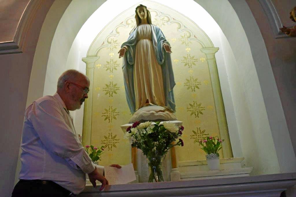 CONDOLENCES: St Patrick's parish priest Adrian Farrelly says he was deeply touched by flowers from Gympie Muslim community members, expressing their sadness and support for victims of the Colombo Easter terror attack on Christian worshippers.