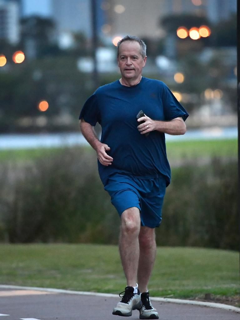 Mr Shorten started the day with a run along the banks of the Swan River on Monday. Picture: AAP/Darren England