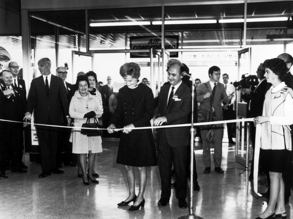 Official opening: Mrs H.B. Cunningham, wife of the President and Chairman of S.S. Kresge Co. Cuts the ribbon to make the opening of Australia's first Kmart at East Burwood, Melbourne. Assisting her is Kmart manager Mr. Langley.