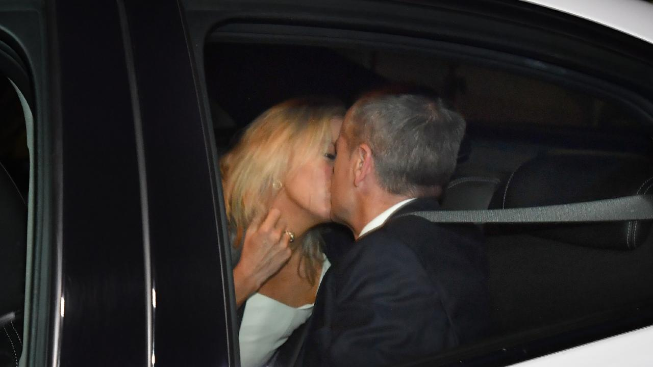 Australian Opposition Leader Bill Shorten kisses his wife Chloe Shorten after his win.