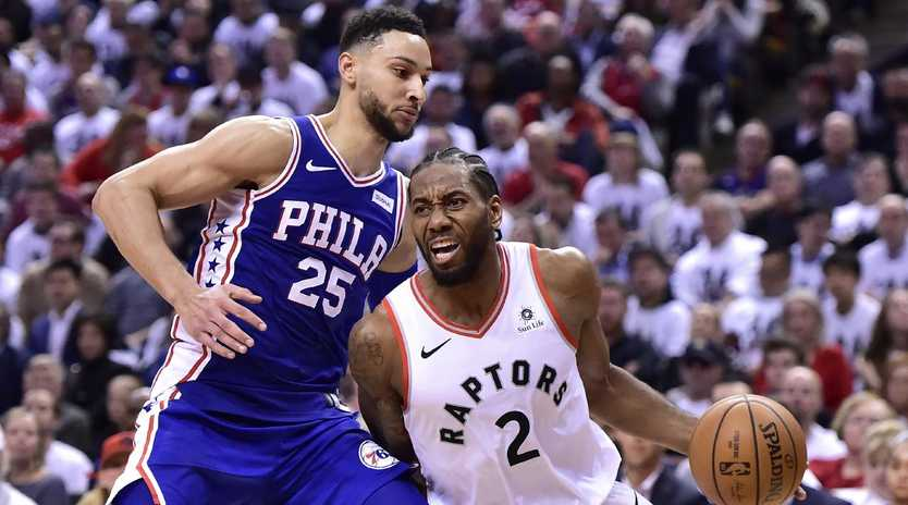 Kawhi Leonard gets the better of Ben Simmons.