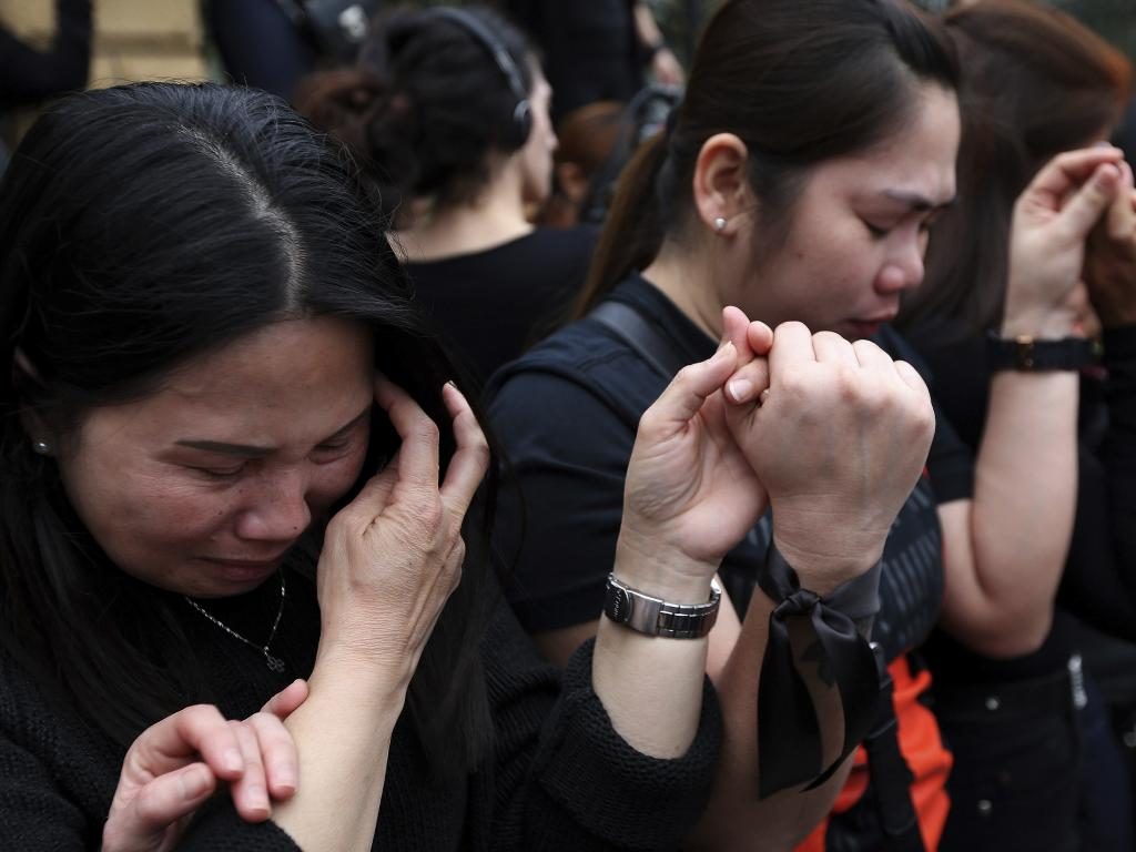 People from Cyprus' large Filipino community weep at Friday's vigil. Picture: Petros Karadjias/AP