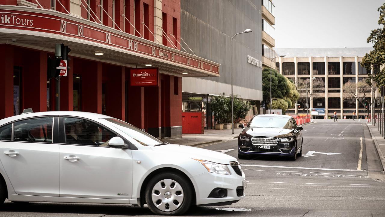 A driverless car (rear) during trials in Adelaide's CBD