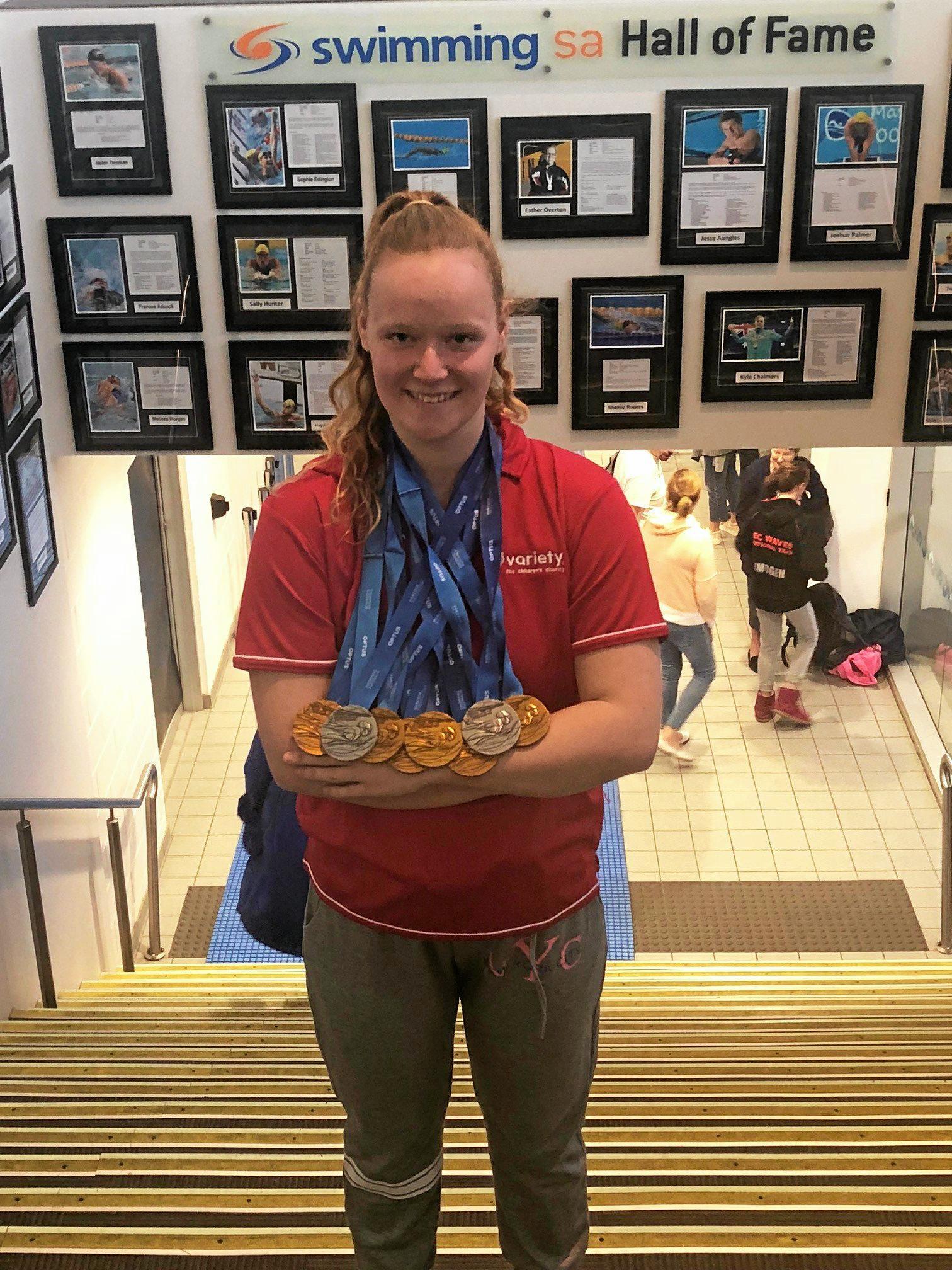 Woogaroo swimmer Poppy Wilson shows off her National Championships medal haul.