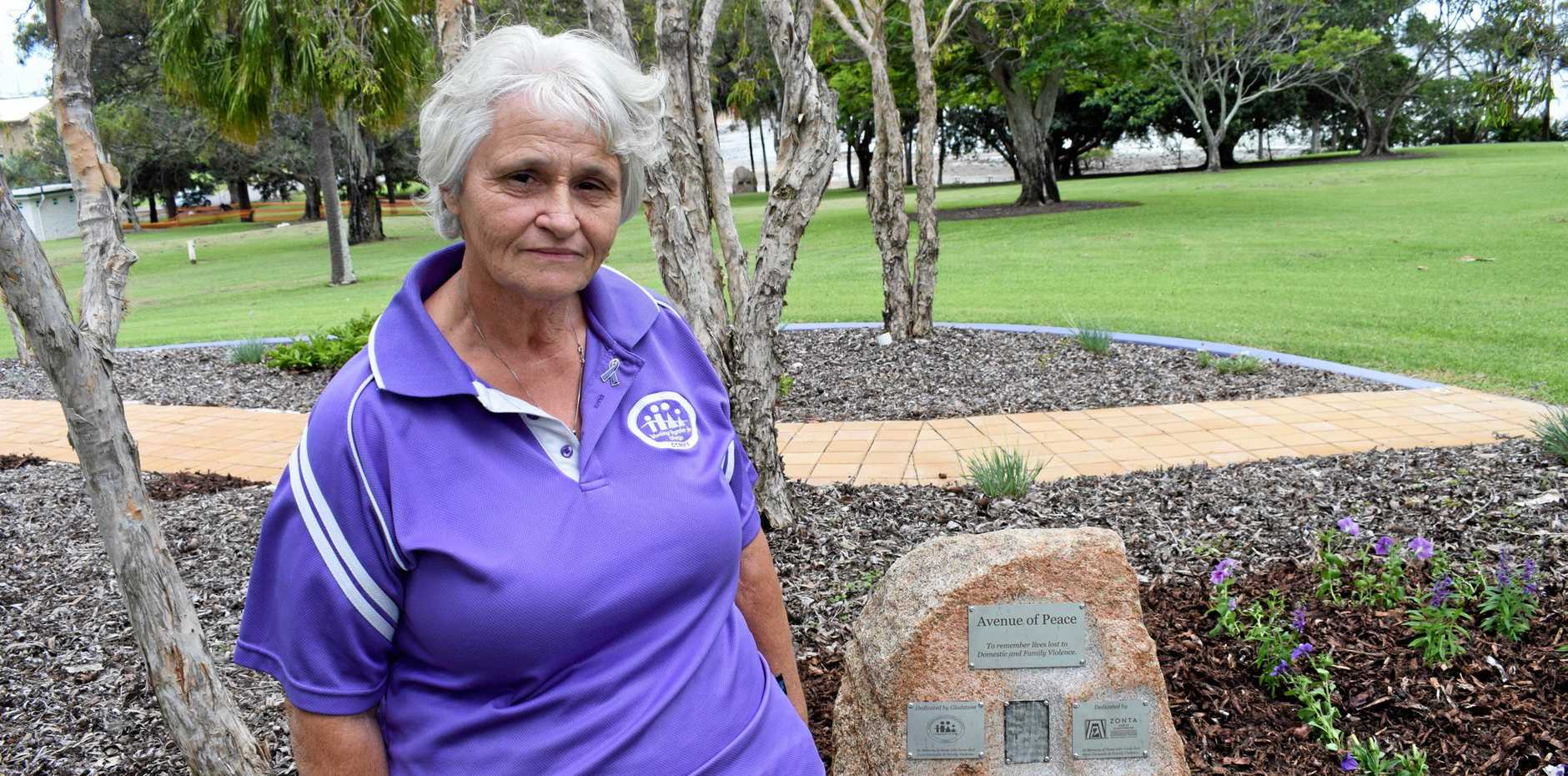 Linda Watson with the plaque in Friend Park at Barney Point which was unveiled today in honour of her daughter who lost her life to domestic violence.