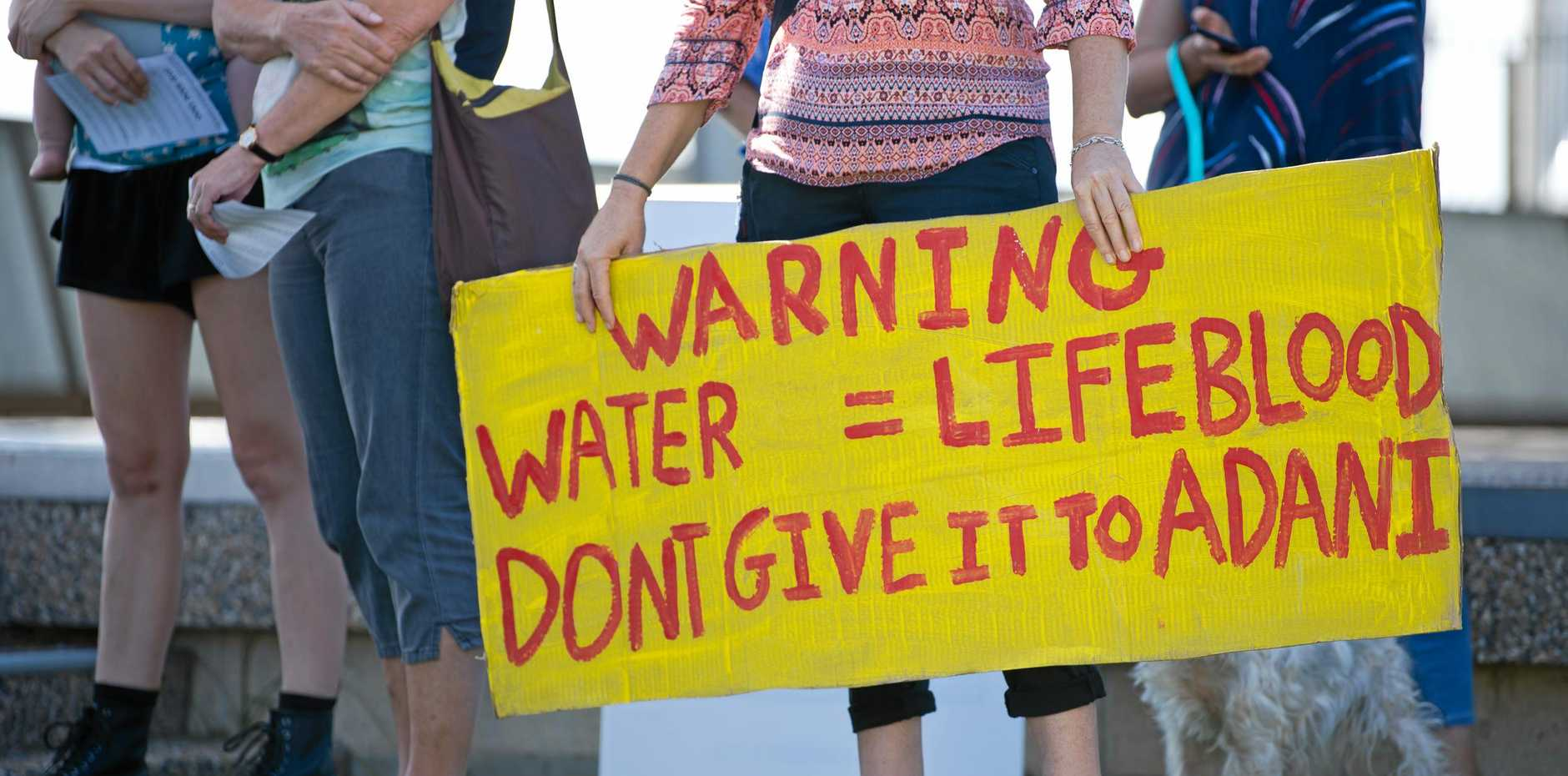 Residents at a 'Walk for Water' through central Mackay to call on the Federal and State Governments to stop Adani's coal mine and protect Queensland's ground and river water.
