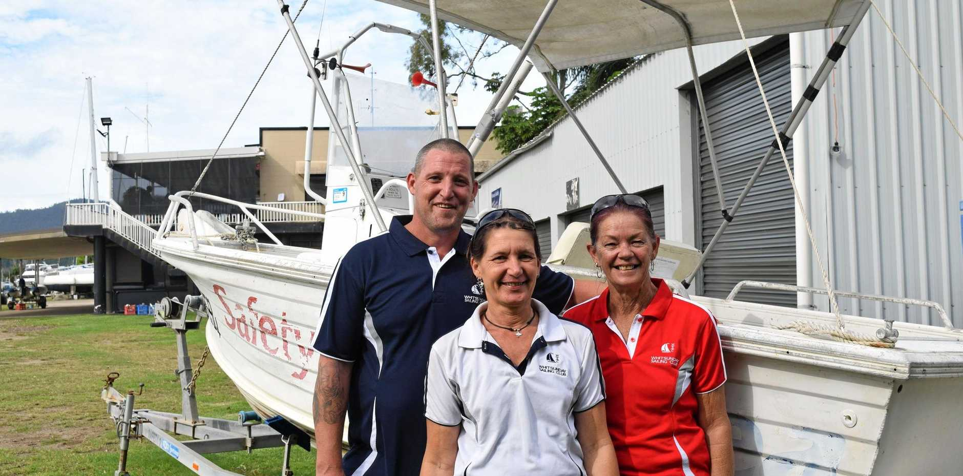 MONSTER WEEKEND: Whitsunday Sailing Club's Danny O'Brian, Leonie Matthews and Darvey Schiller with one of the boats for sale at the Monster Car Boot Sale this Sunday.