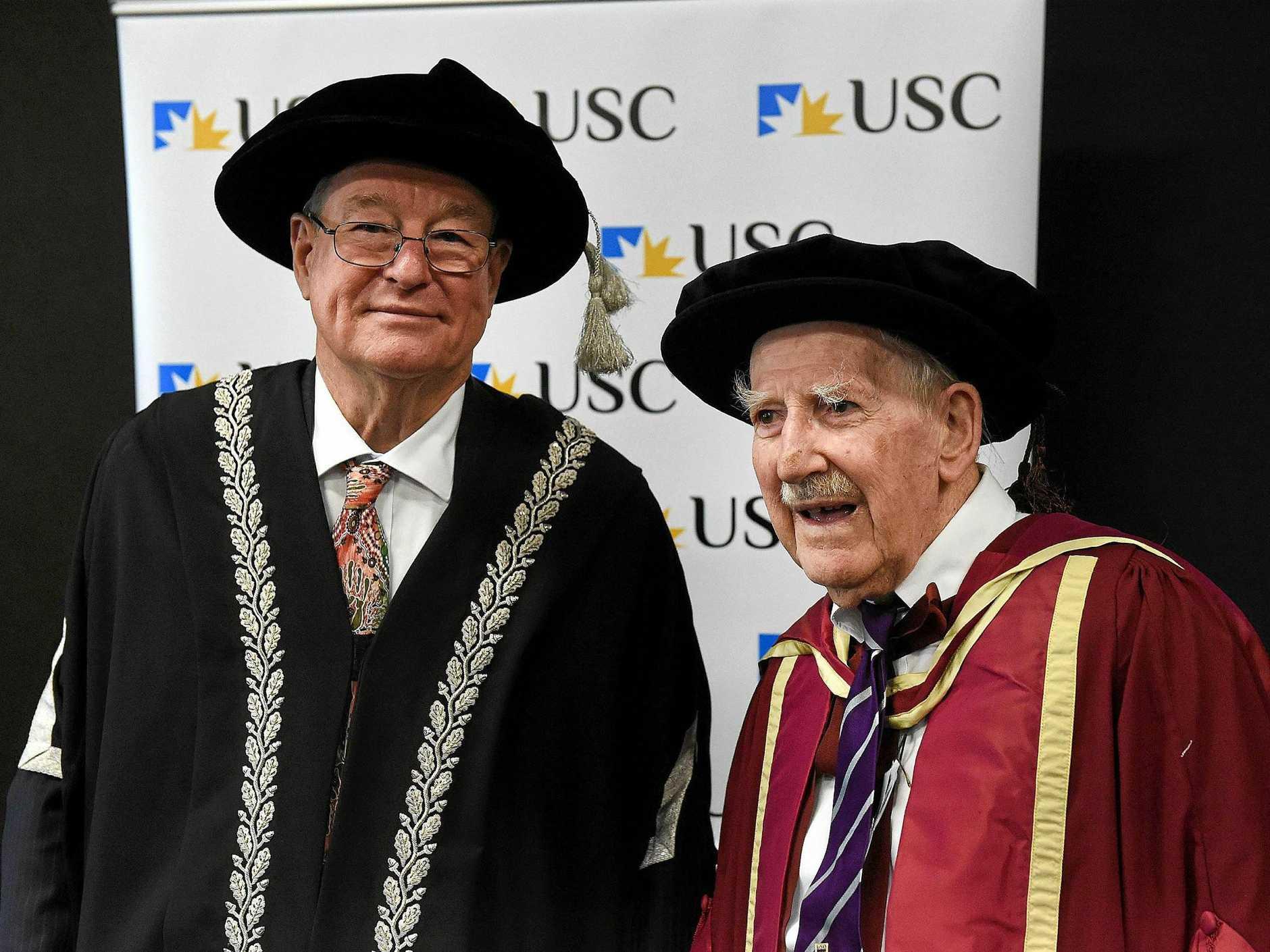 USC GRADUATION: Vice Chancellor professor Greg Hill and Vernon Harris, right.