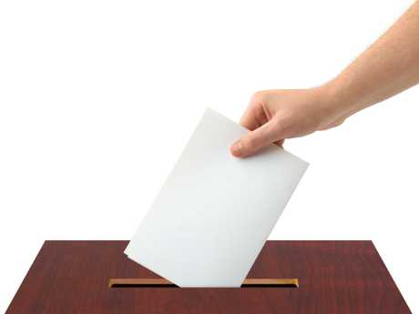 Thinkstock generic image of hand voting, putting piece of white paper into ballot box.