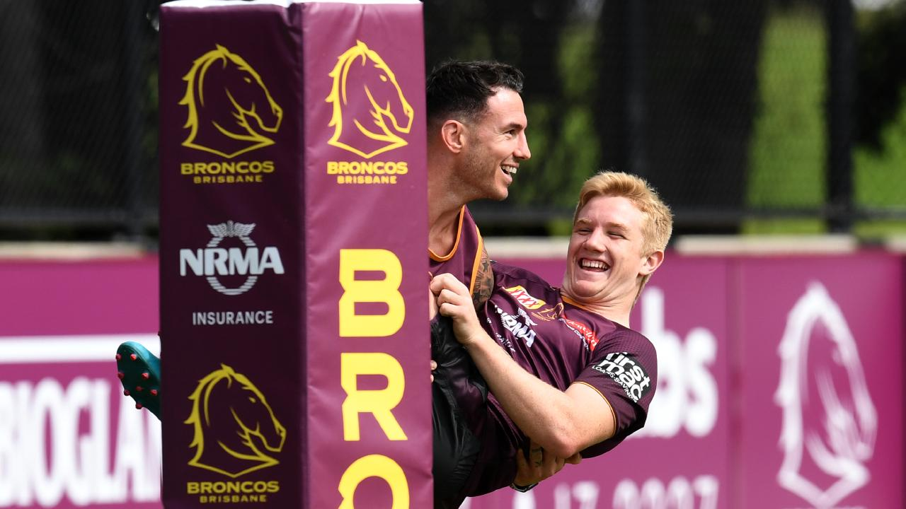 Brisbane Broncos captain Darius Boyd carries Tom Dearden over the try line at training. Picture: AAP Image/Dan Peled
