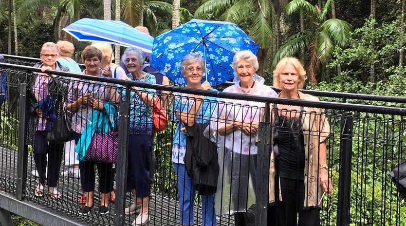 SINGING IN THE RAIN: Burleigh Heads Ladies Probus Club members enjoyed the Skywalk in the Gold Coast Hinterland.