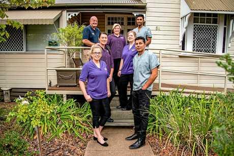 Country Smiles Dental Services family: Kate Nolan, Kira Wilde, John Payne, Liz Saunders, Dr Sadit Reza, Sheri Walker and Shareef Hamdam.