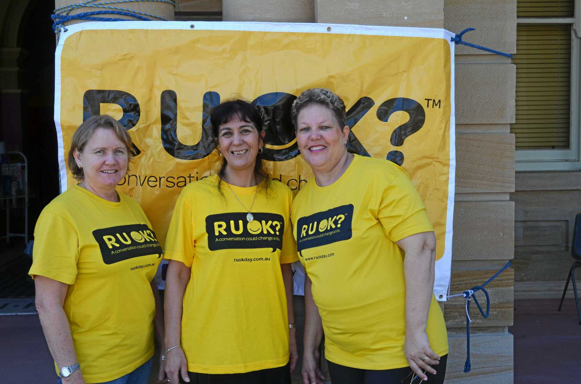 Ann Felton, Valerie White and Marcelle Thompson help out at the R U OK stand in front of the Town Hall yesterday.  Photo Katie Cameron / Warwick Daily News