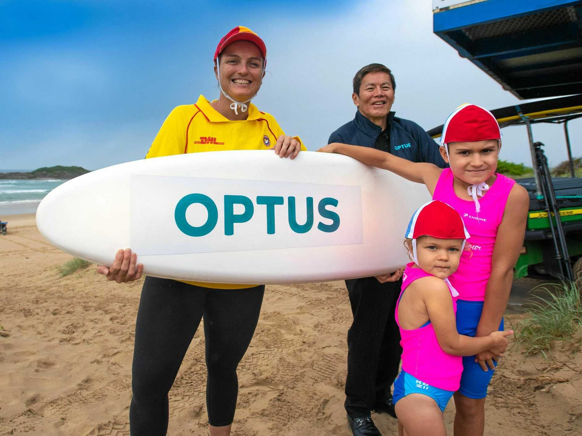 VALUED PARTNERSHIP: Coffs Harbour Surf Lifesaving Club directr Rachael Smyth, nippers Alexis and Harry Wills and Optus CEO Allen Lew.