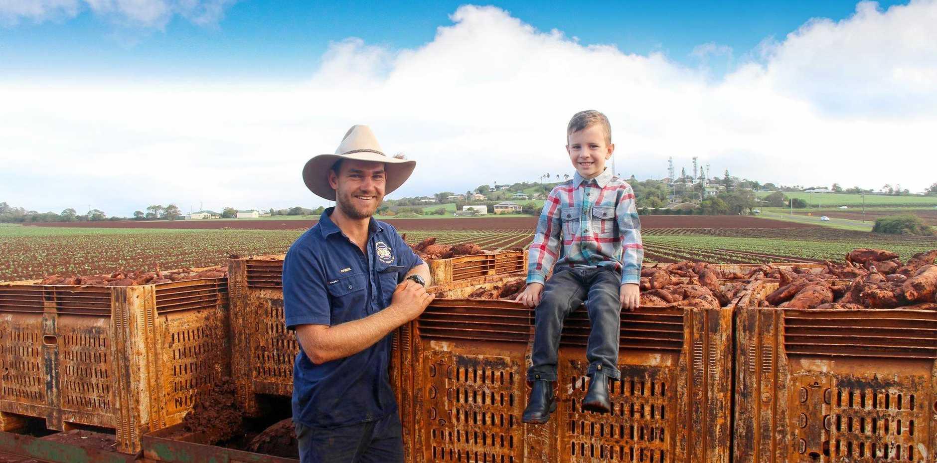 TASTE: Sweet potato farmer Ethan Zunker and five-year-old Jack Tonkin are ready to celebrate at the inaugural Taste Bundaberg Festival.