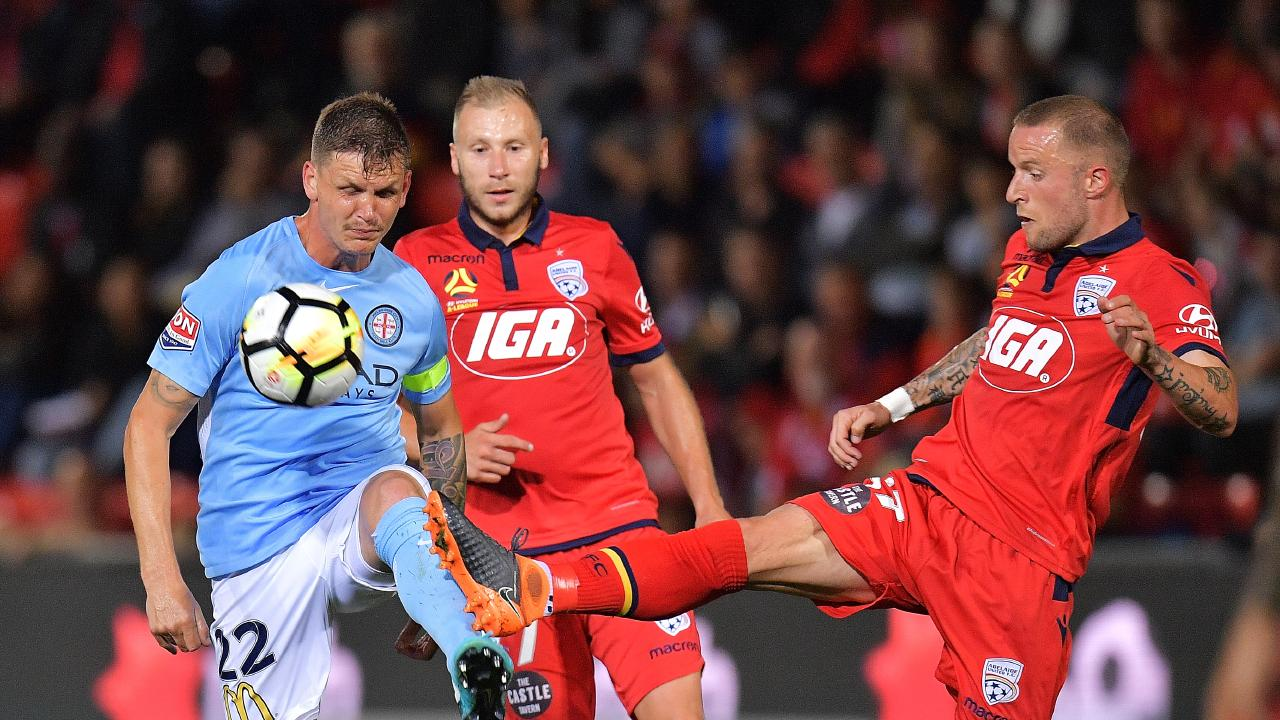 ADELAIDE, AUSTRALIA - MARCH 16: Michael Jakobsen of Melbourne City competes for the ball with Daniel Adlung of United during the round 23 A-League match between Adelaide United and Melbourne City at Coopers Stadium on March 16, 2018 in Adelaide, Australia.  (Photo by Daniel Kalisz/Getty Images)