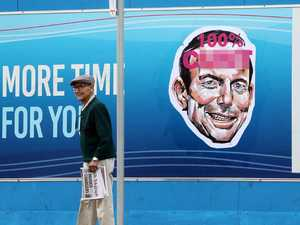 Vile posters of Tony Abbott plastered across city