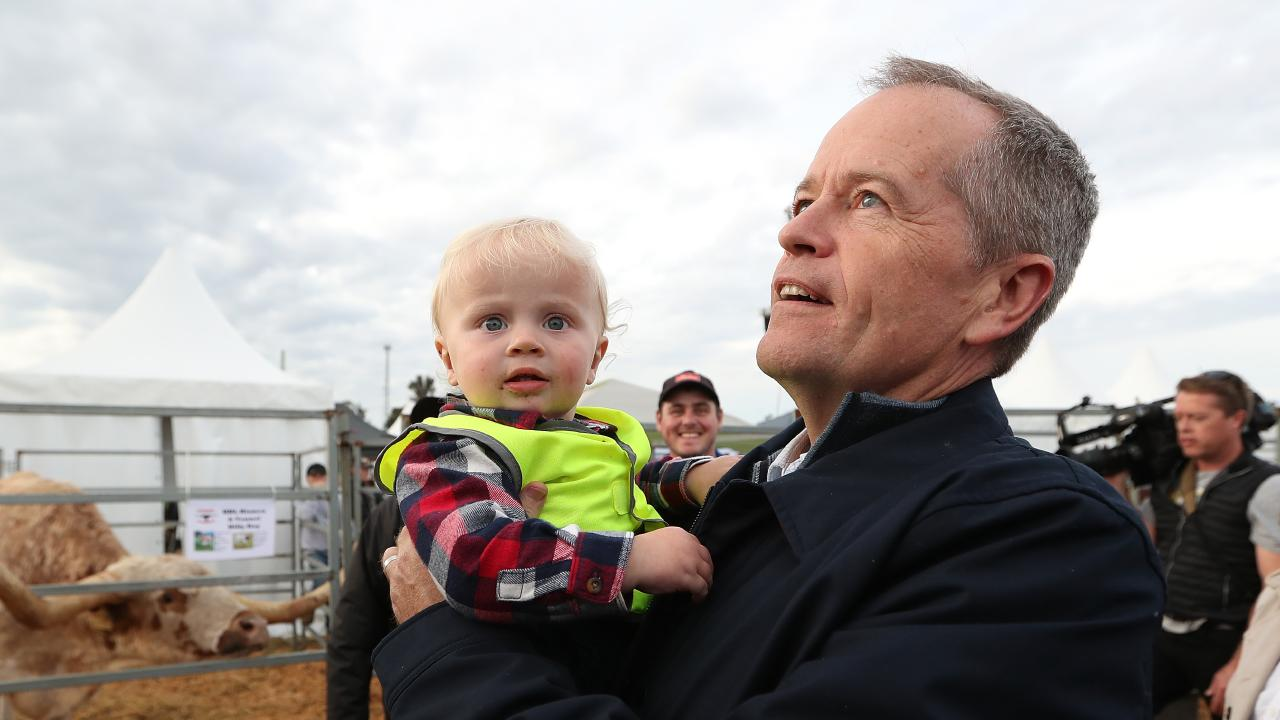 Opposition Leader Bill Shorten holds 18-month old Harvey Cresswell while attending AGFEST at Carrick, in Tasmania. Picture: Kym Smith