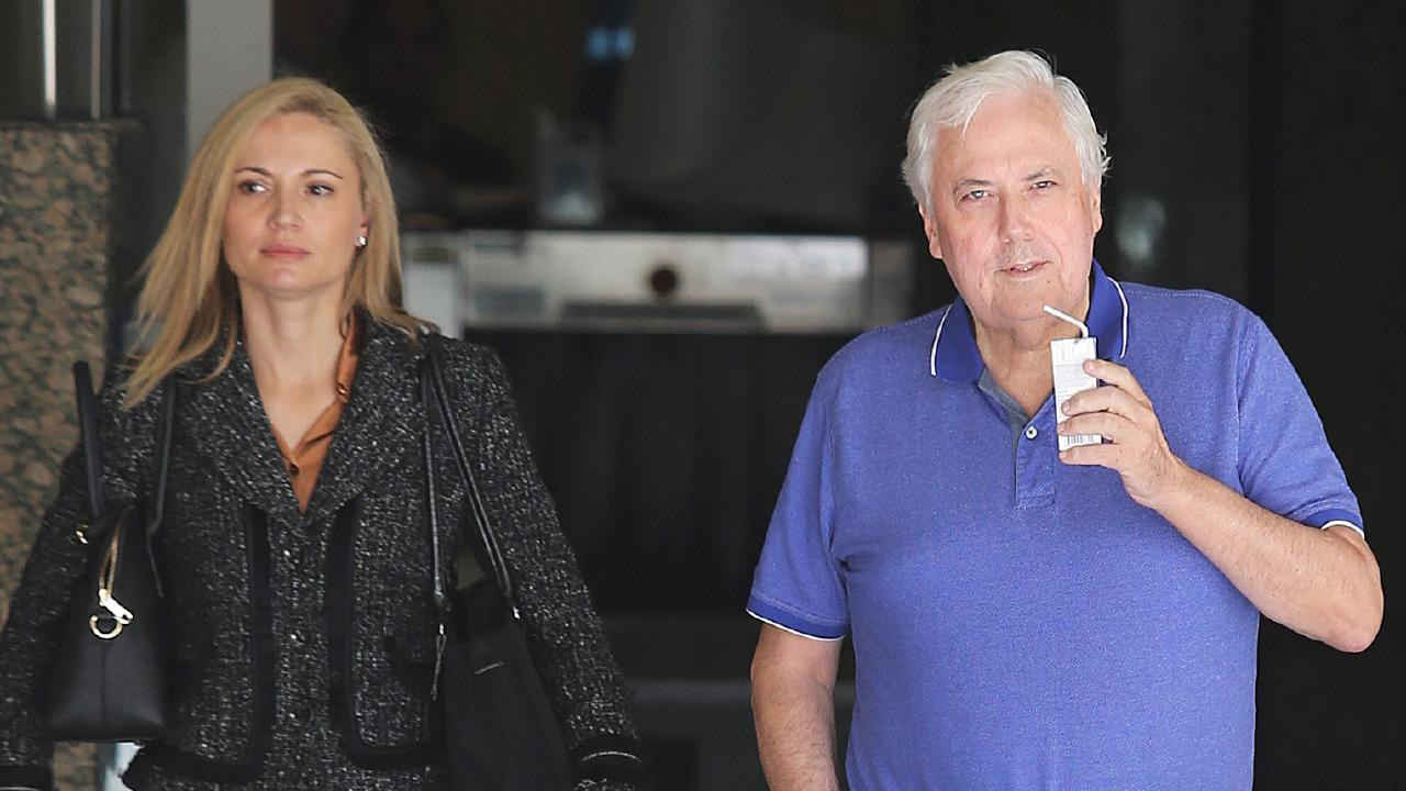 Clive Palmer and his wife Anna (left) leaving the Federal Court after giving evidence at the public examination of the collapse of Queensland Nickel. Picture: Claudia Baxter