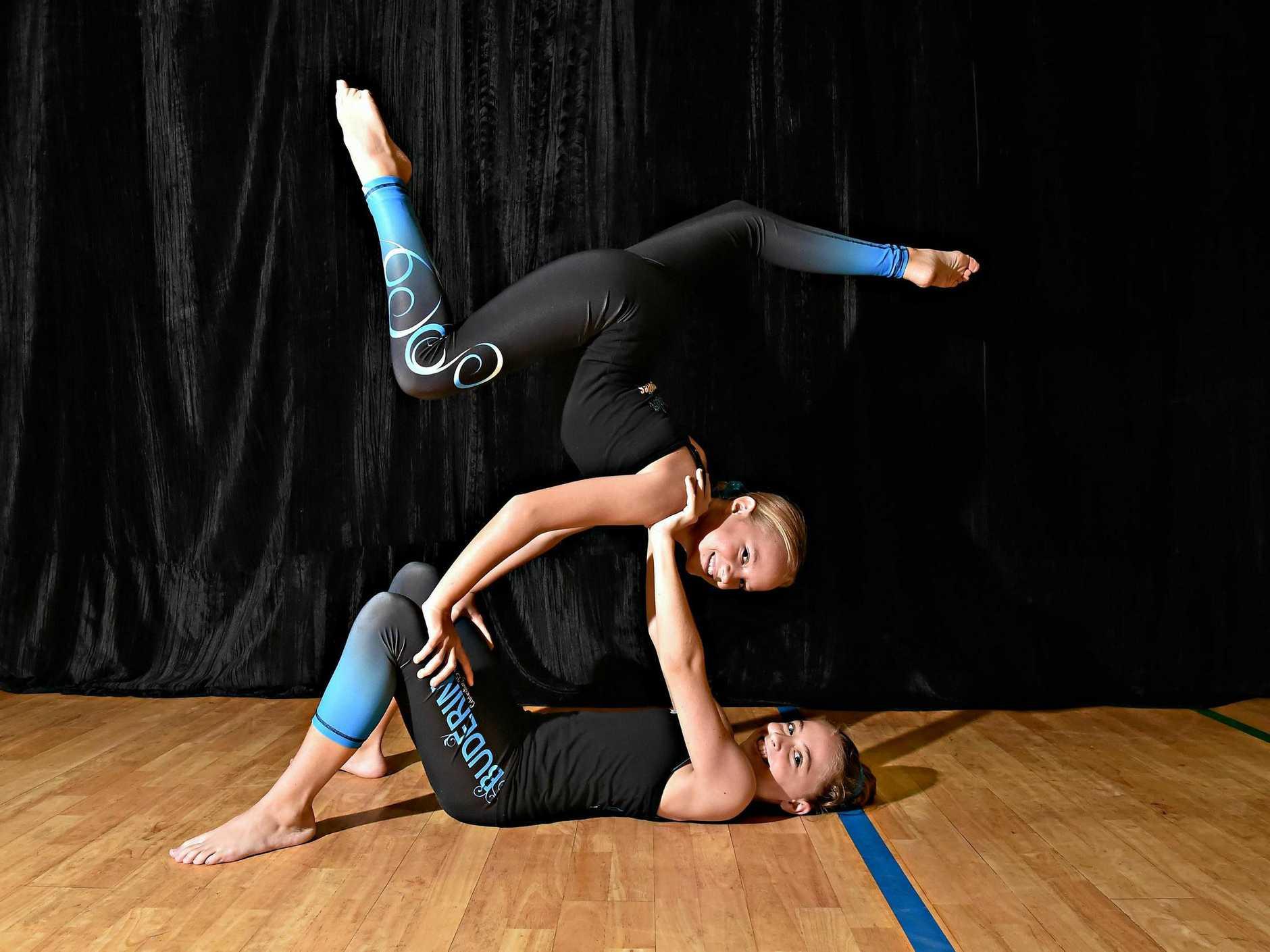 ON TOP: Tilda Pirest and Sierra Andrews show off their skills at a Calisthenics Buderim class.