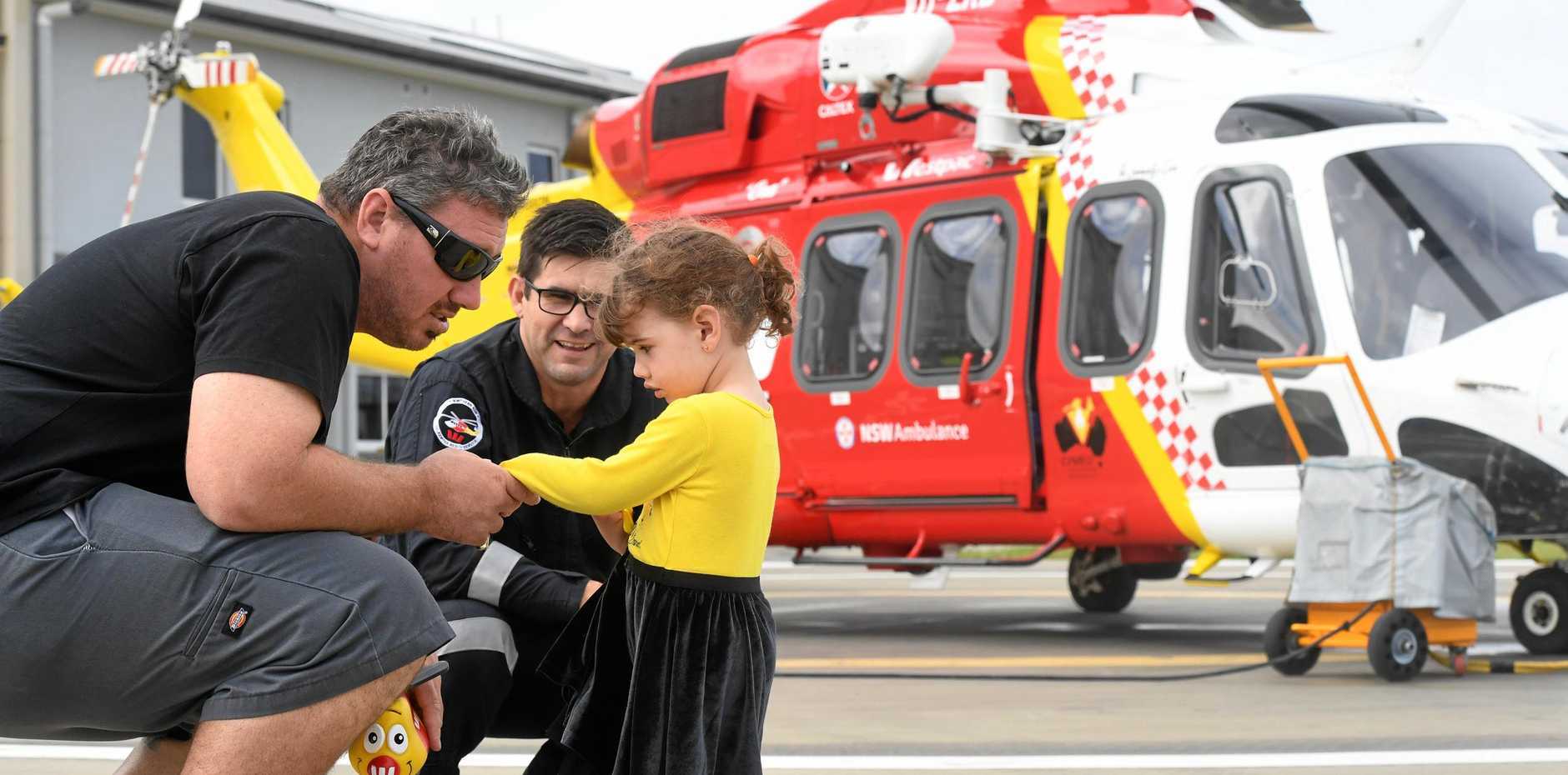 SPREADING THE LOVE: Josh and Bella Joy Cleary meet with Westpac Life Saver Rescue Helicopter pilot John Walker after donating money to the lifesaving organisation which airlifted Mr Cleary's wife Renee to the Gold Coast following a brain haemorrhage.