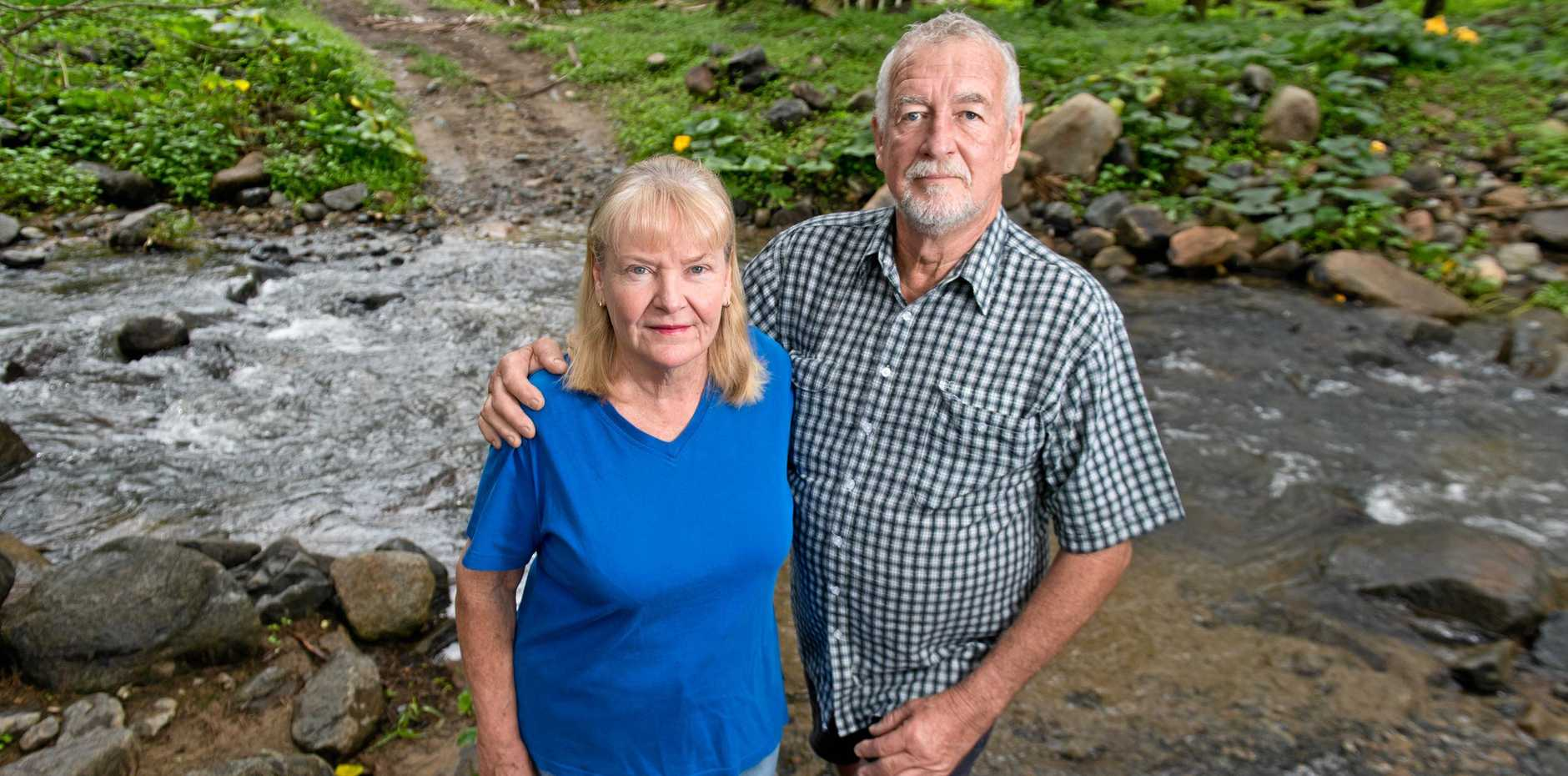 Netherdale residents Win and James Arnold say they are fed up with finding mango waste in a creek that runs through their property.