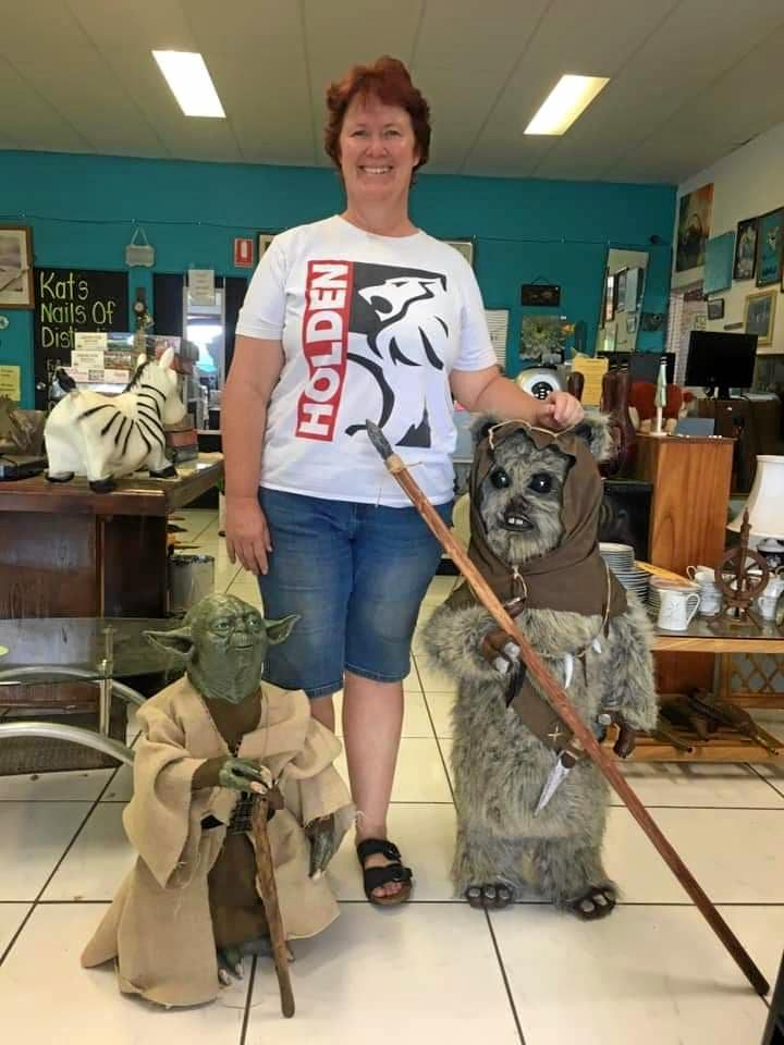 Annette Anderson's sister Tina Gurr with a lifesize replica of Yoda and an Ewok.