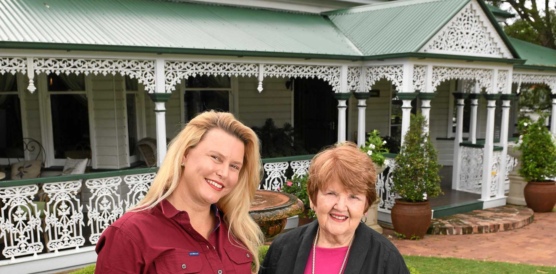GRAND DESIGNS: Simone Hubbard and Carolyn Whetter from the National Trust of Queensland Ipswich Regional Branch pictured outside Lakemba, one of the three homes to be featured.