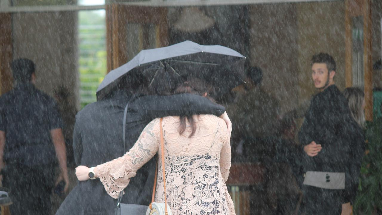 Rain fell as mourners entered the Birkdale church to celebrate the life of Private Liam Wolf. Picture Andrea Macleod
