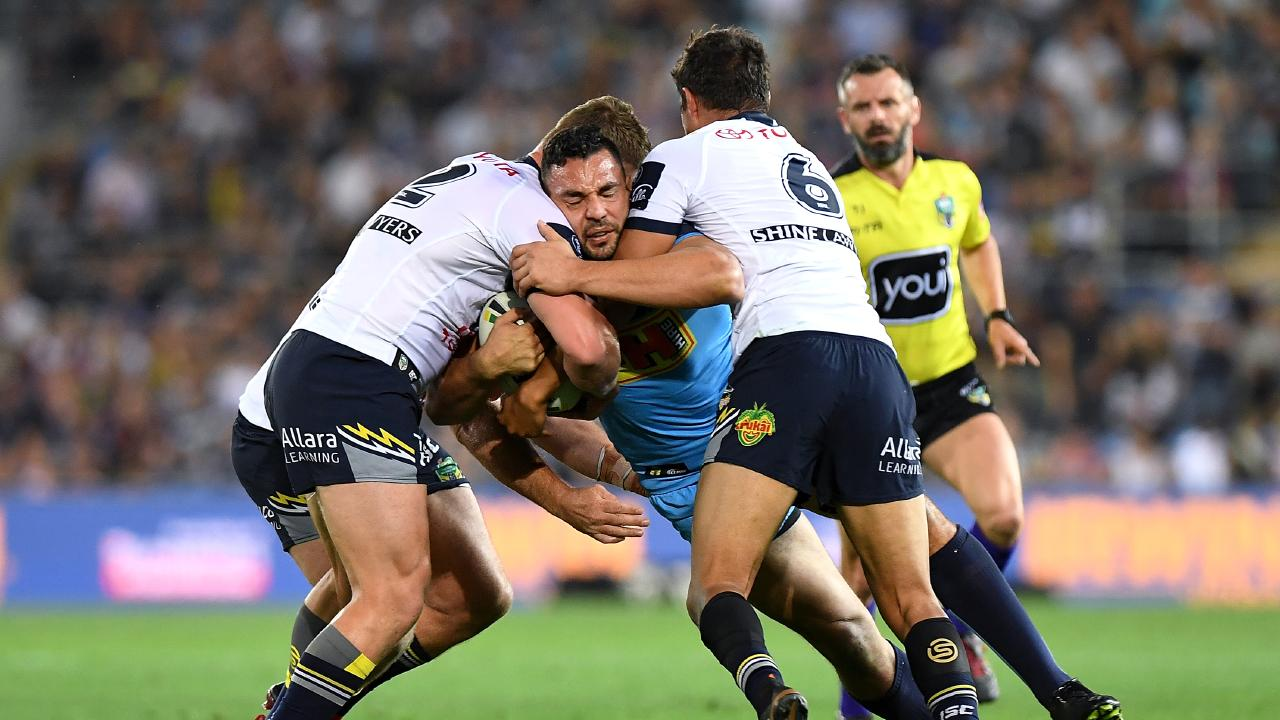 Ryan James of the Titans takes on the defence during the round 25 NRL match between the Gold Coast Titans and the North Queensland Cowboys at Cbus Super Stadium on September 1, 2018.