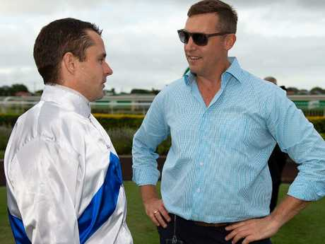 "Trainer Tony Gollan (right), with jockey Brad Stewart, says Zoustyle appears ""an improved horse"" this time in. Picture: Albert Perez"
