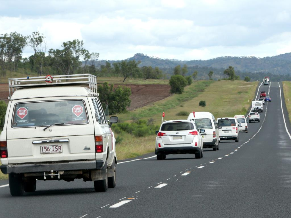 The Bob Brown led Anti Adani Convoy, heading for Clermont, on Saturday, April 27, 2019 Picture: AAP/Steve Pohlner