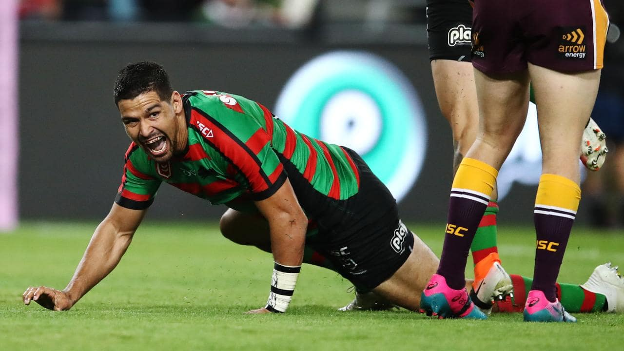 Cody Walker celebrates a try with a goanna tribute to Greg Inglis.