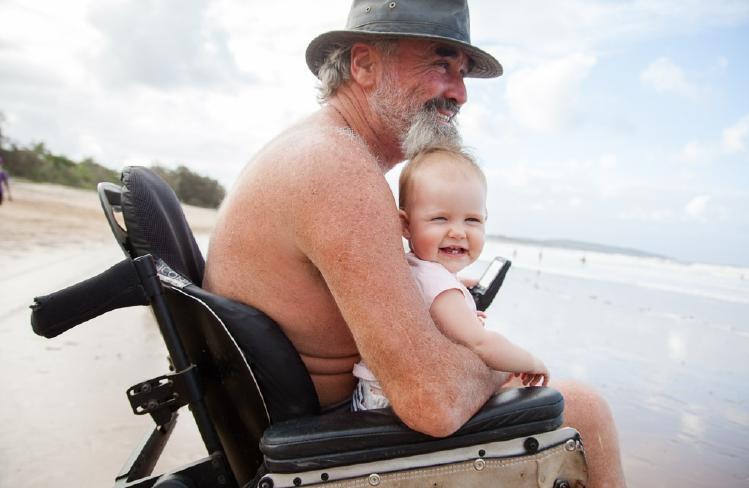 Howard Springs quadriplegic Paul McKenzie, with his daughter Eleven. Picture: JESSICA PARKER