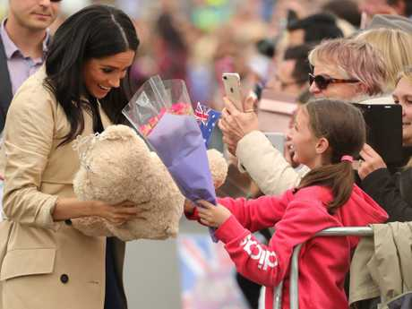 Meghan gets flowers and a bear from 10-year-old Courtney Pistons. Picture: Stuart McEvoy