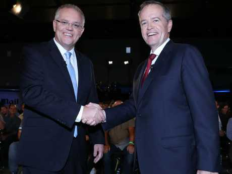All smiles as Scott Morrison and Bill Shorten square up in Brisbane last night. Picture: Gary Ramage