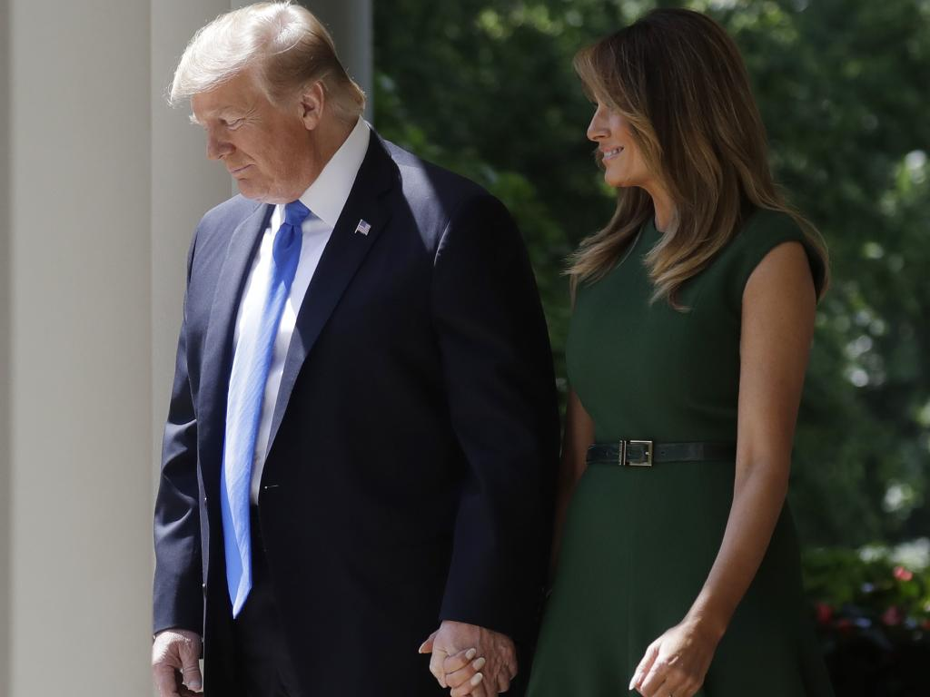 US President Donald Trump and first lady Melania Trump walk out to participate in a National Day of Prayer event. Picture: AP
